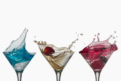 Cocktail splash free cups Royalty Free Stock Photography