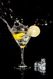 Cocktail with splash and  lime Royalty Free Stock Image