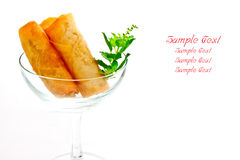 Cocktail springroll. On white background with space for filling texts Stock Images