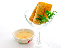 Cocktail springroll with sweet plum sauce. On white background Royalty Free Stock Photography