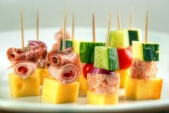 Cocktail stick snacks. Different cocktail stick snacks , with cheese , zucchini , meat jelly , cucumber and cold cuts rolls Stock Image