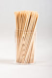 Cocktail Sticks. A set of cocktail sticks in a hexagonal plastic container Royalty Free Stock Image