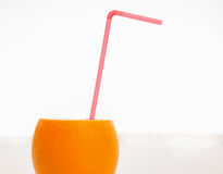 Cocktail straw in a fresh juicy orange Royalty Free Stock Image