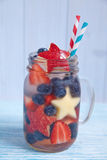 Cocktail with strawberry, blueberry and apple Stock Image