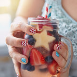 Cocktail with strawberry, blueberry and apple Royalty Free Stock Images