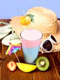 Cocktail, strawberry, mango and kiwi, with holiday background Royalty Free Stock Images