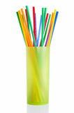 Cocktail straws. In a plastic cup on white background Stock Photo