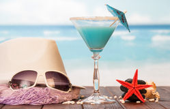 Cocktail, sunglasses and hat Royalty Free Stock Image