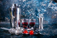 Cocktail with sweet flavour in small glasses. alcoholic drinks at bar Stock Images