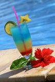 Cocktail by the swimming pool Royalty Free Stock Photo