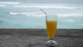 Cocktail on the table overlooking the ocean or sea. The concept of leisure and travel. stock footage