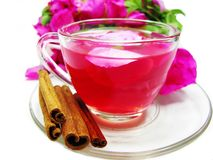 Cocktail tea drink with wild rose and cinnamon Stock Photos