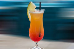Cocktail Tequila sunrise, background intentional motion blur. Royalty Free Stock Photos