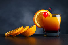 Cocktail Tequila sunrise with orange and cherry Royalty Free Stock Images