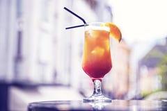 Cocktail on the terrace. Cocktail on the terrace with orange slice Stock Photos