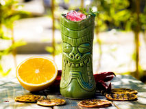 Cocktail in the tiki glass royalty free stock photography