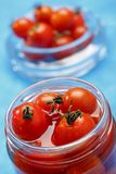 Cocktail tomatoes in jar Stock Photos