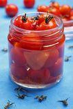 Cocktail tomatoes in jar Stock Photo