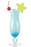 Cocktail tropical bleu avec de la crème de noix de coco Photographie stock libre de droits