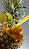 Cocktail with tropical fruit Stock Photos