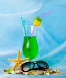 Cocktail with tropical starfish and glasses Royalty Free Stock Image