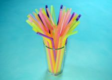 Cocktail tubes. And glass colorful beautiful Stock Images