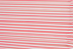 Cocktail tubes with red stripes background. Background tubes for red and white cocktail Stock Images