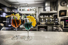 Cocktail. Two colored cocktail on benach of bar Royalty Free Stock Photography