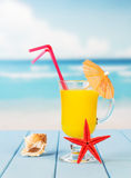 Cocktail with umbrella against the blue Stock Photo