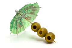 Cocktail umbrella and olives. Stock Images