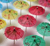 Cocktail Umbrella Pattern. Cocktail umbrellas of different colors arranged in a pattern Royalty Free Stock Image