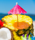 Cocktail umbrella on a pineapple half Stock Photography