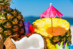 Cocktail umbrella on a pineapple half Royalty Free Stock Images