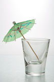 Cocktail Umbrella shot glass. Green drink umbrella in a shot glass Stock Photo