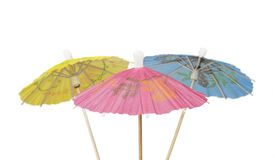 Cocktail Umbrellas. Multicolored Cocktail Umbrellas, spring and summer symbol,isolated on white background,selective focus Royalty Free Stock Images