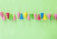 Cocktail umbrellas on Green. Colorful cocktail umbrellas on Green paper background royalty free stock images