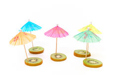 Cocktail umbrellas on the kiwi Royalty Free Stock Photography