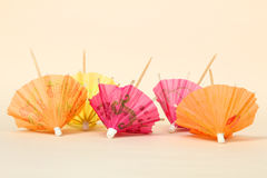 Cocktail umbrellas. Multi-colored cocktail umbrellas on a light background royalty free stock photo