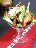 Cocktail of vegetables with bread. Cocktail of vegetables served raw as a salad with a bread basket stock photography