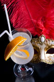 Cocktail and Venetian mask. On a black background Royalty Free Stock Photo