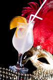 Cocktail and Venetian mask. On a black background Stock Photography