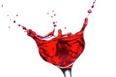 Cocktail vermelho com respingo Foto de Stock Royalty Free