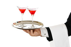 Cocktail Waiter. Carrying two cherry cocktails in glasses on silver tray royalty free stock photos