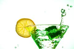 Cocktail water drink splash in the glass with lemon Isolated on white. Background stock photos
