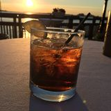 Cocktail On The Waterfront. Jack and Coke at sunset on the waterfront in downtown Buffalo New York Royalty Free Stock Photo