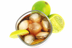 Cocktail with whisky, cola and fresh lime Royalty Free Stock Image