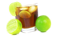 Cocktail with whisky, cola and fresh lime Stock Images