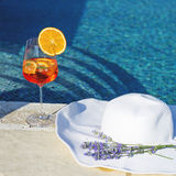 Cocktail and white hat near swimming pool Royalty Free Stock Images