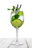 Cocktail in wine glass made with champagne, soda, lime, mint on white background. Royalty Free Stock Photos