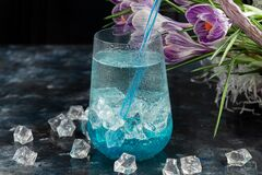 Free Cocktail With Blue Liquor And Ice. Celebratory Drink For Women`s Day, Birthday, Easter. On A Dark Background Royalty Free Stock Photography - 173244307
